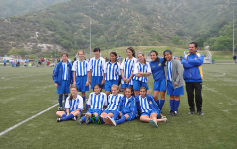 Senior Ani Mard poses for a photo with her previous soccer team.