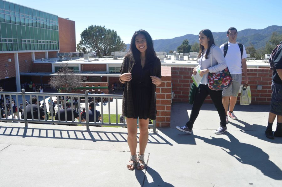 """Jada Javier, junior, wears brown on black to bring out fall colors that complete a casual look. Javier said, """"I can just throw on a cardigan in the mornings to stay warm; it's fun, easy, and cute."""" She finishes off her outfit with a cute pair of sandals."""