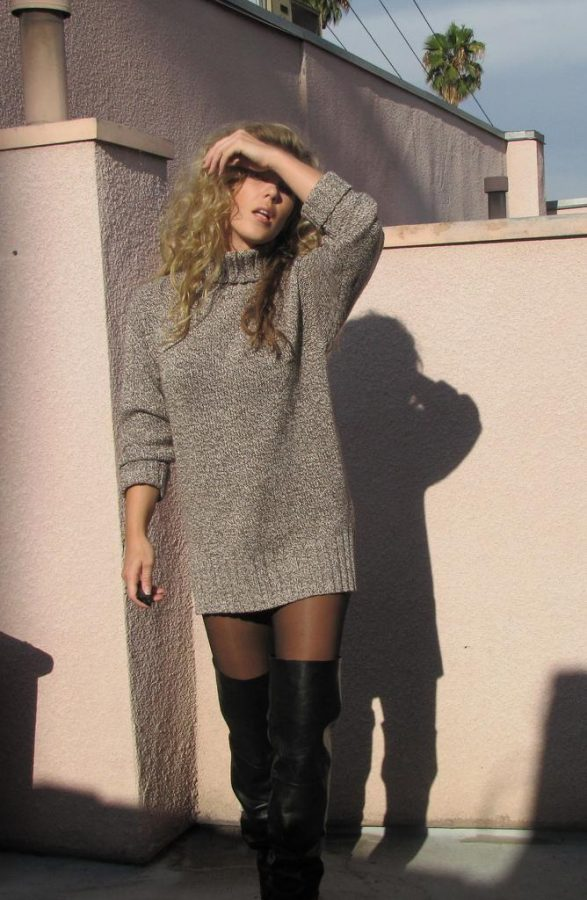 Sweater dresses are easy to throw on with a pair of tights and boots; light grey is perfect for Winter. The look is easy to throw on and looks like you've put a lot of time in it! The messy curls complete the urban look for a fun night out with some friends.