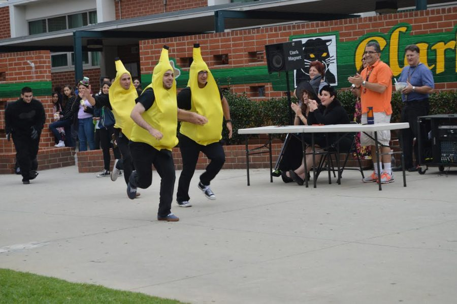 The gorilla chases the three bananas during the Clark annual costume contest. They're costume won an honorable mention by the judges.