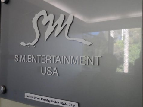 A small, modest gray sign greets K-pop star hopefuls who go to S.M. Entertainment's Los Angeles office.
