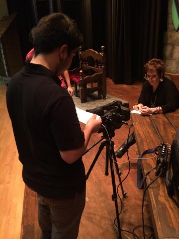 Junior Argeen Ghazarian from Clark's cinematography class gets some B-roll footage of the Director, Barbara Zatarain, to use later in background footage. Miss Zatarain has been directing plays at Wilson Middle School for the past fifteen years.