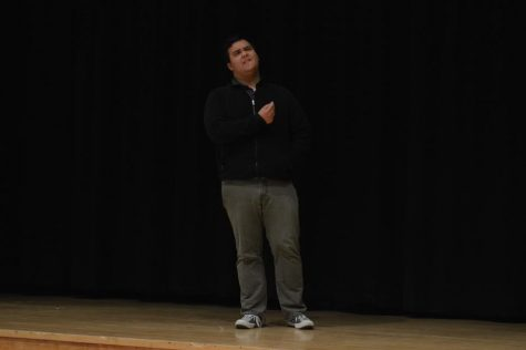 Winner Zachary Blue performs a scene from Othello.