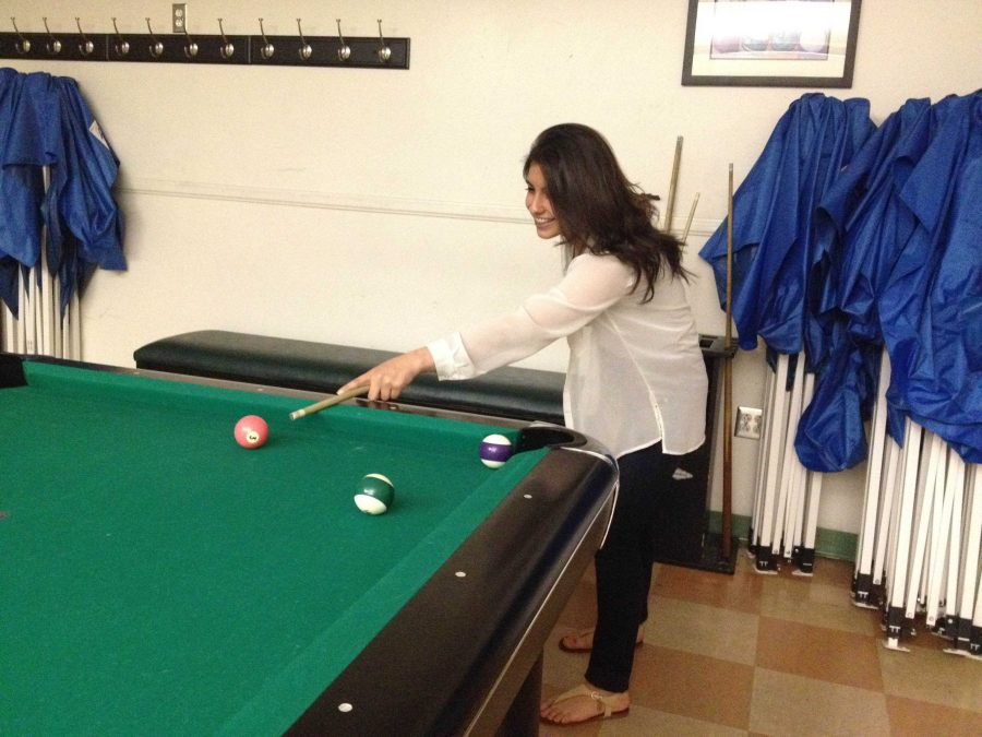 Hoover High School junior Mane Vahanian attempts to play a game of pool, on of th many activities you can participate in at one of these events.
