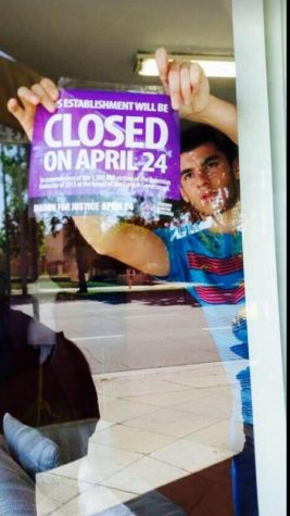 Senior Raffi Jivalagian puts up poster in store front claiming the store to be closed on April 24th.