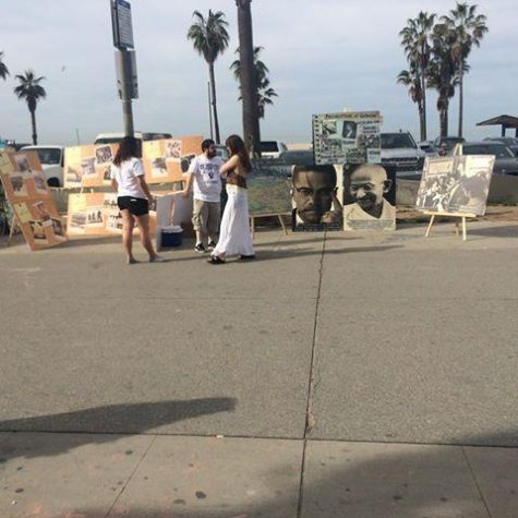 AYF members post up informational posters in Venice Beach.
