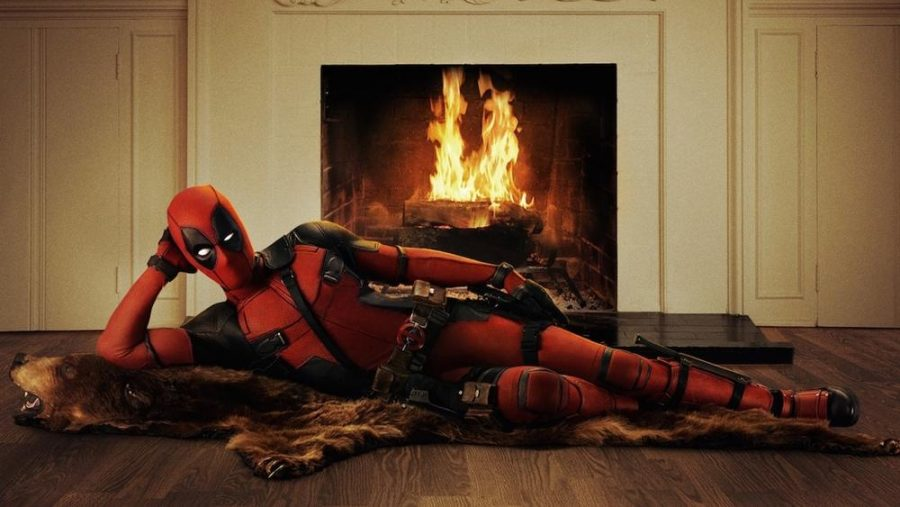 The+suave+Wade+Wilson%2FDeadpool+lounges+by+a+fire+on+a+bearskin+rug.