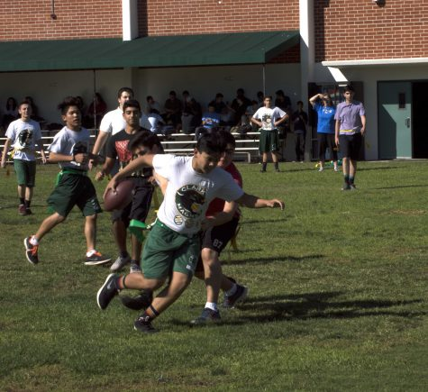 Sophomore Ivan Mariano runs with the ball in last weeks Superbowl XV.