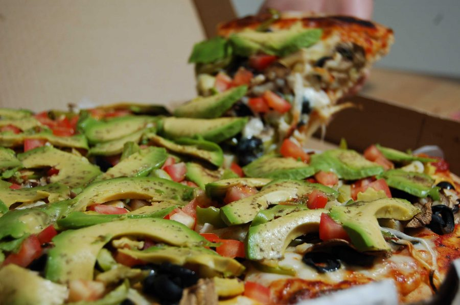 The+overloaded+veggie+pizza+proves+to+be+a+wonderful+invention+of+Mario%27s+that+brings+delight+to+customers%27+taste+buds.