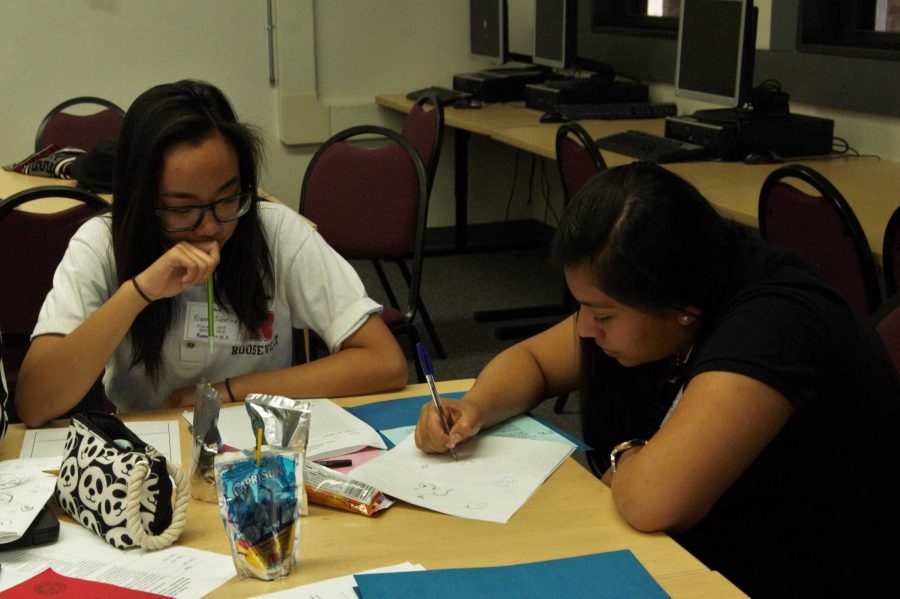 Melissa Diaz-Mancio assists a student in designing their anti-tobacco PSA.