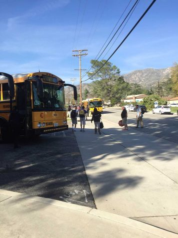Students are carefully walking from their enrichment class after school to their buses.