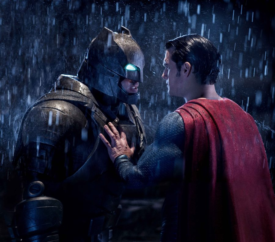 Batman+%28Ben+Affleck%29+and+Superman+%28Henry+Cavill%29+prepare+to+engage+in+battle.%0A