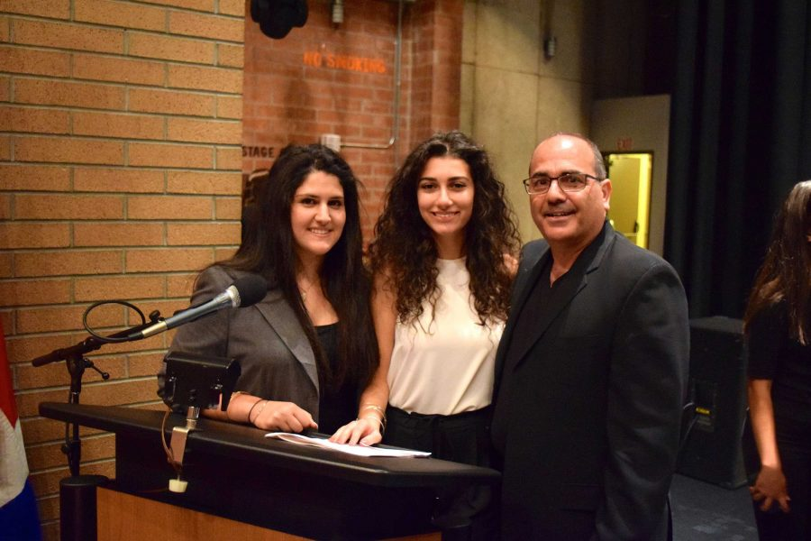 Clark seniors Tina Keshishian and Preny Alaverdian take a picture with school board member, Greg Krikorian after the event.