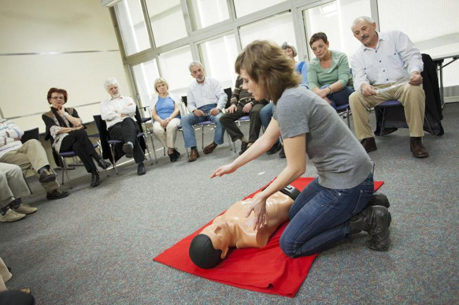 A first aid trainer demonstrates CPR.