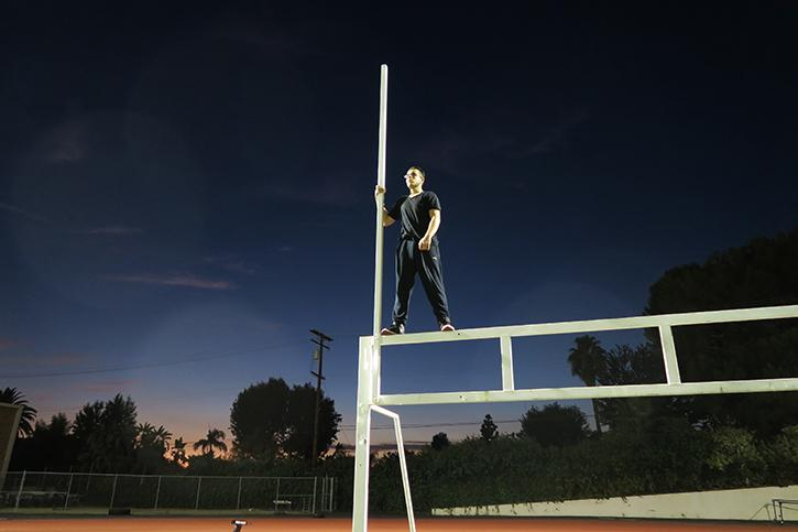 Sophomore Ayedin Mahmoudi climbs a beam on the Hoover field.