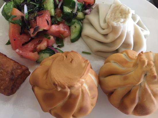 Steamed and Fried Khinkali, Mediterranean Salad, Blinchik      Photo via http://www.tkfrestaurant.com under Creative Commons License