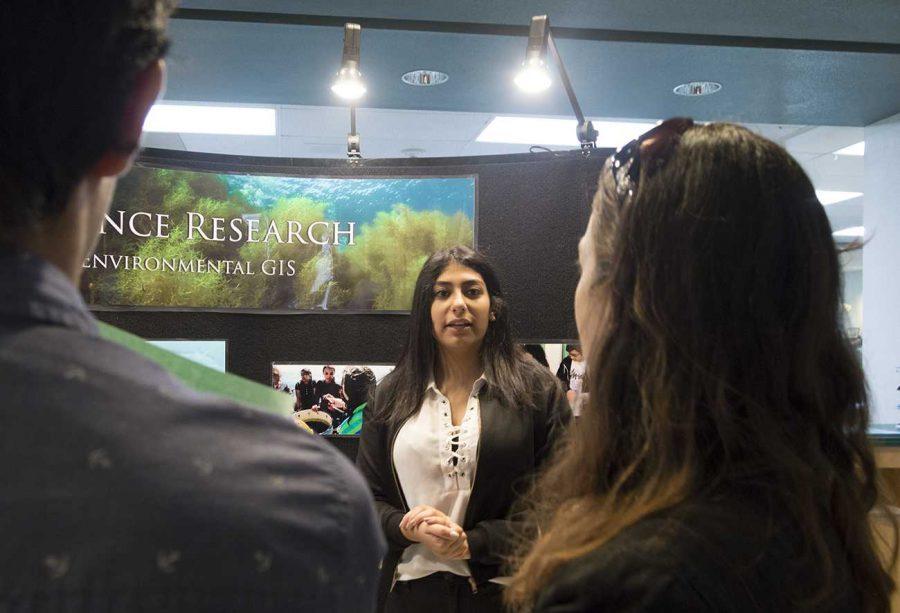 Senior Sandra Gadalla introduces Environmental GIS to curious parents.