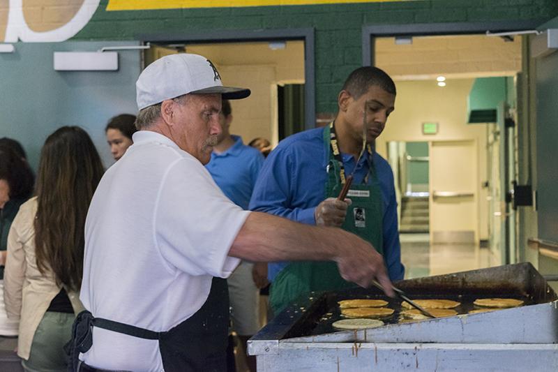 Mr. Axelgard makes the pancakes.