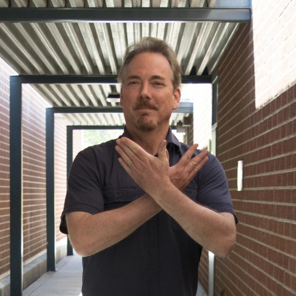 Mr. Over impersonates Dr. Strange.