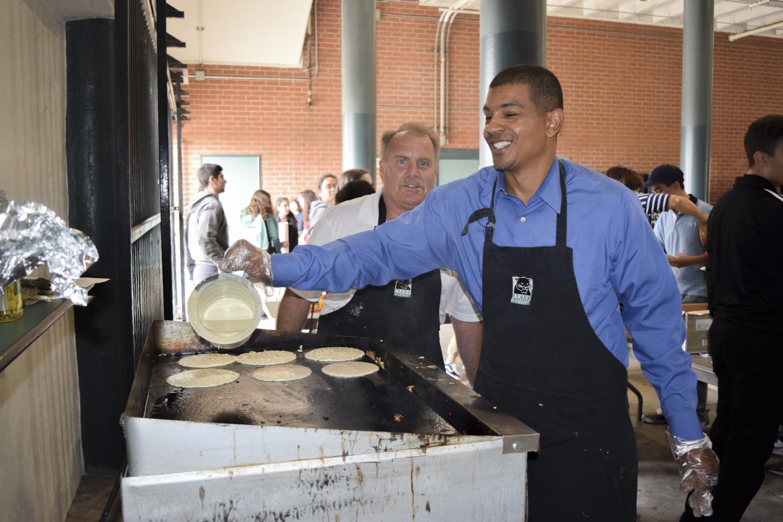 English+teacher+Conrad+Pruitt+cooks+pancakes+for+the+freshmen
