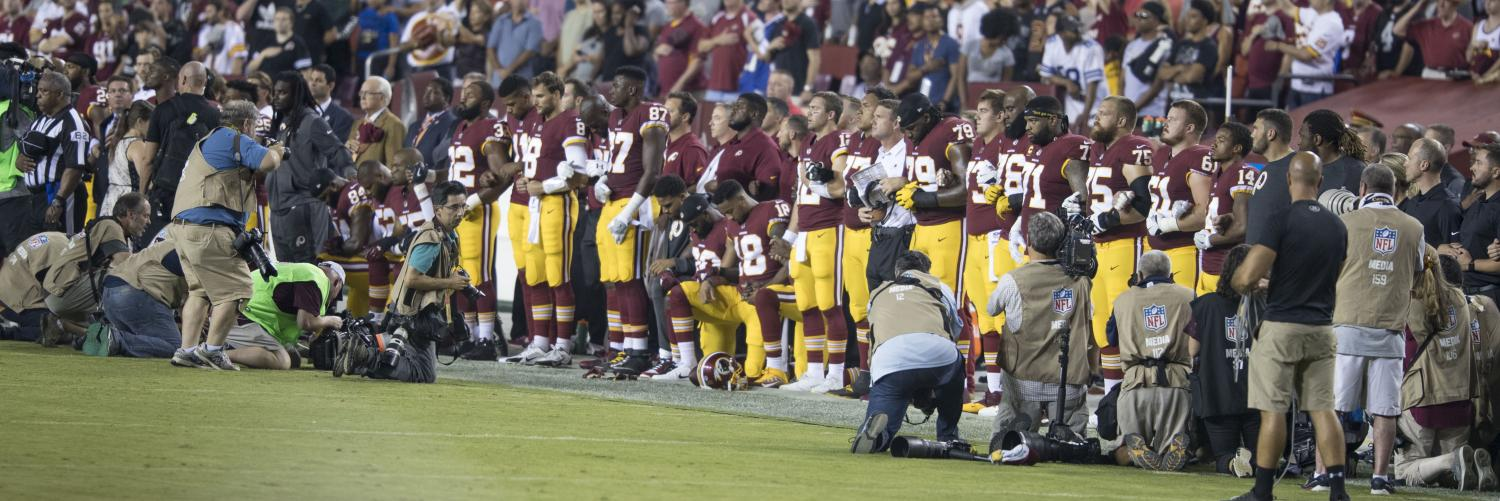 The Washington Redskin players lock arms together during the national anthem. It was one of the many protests sparked by former NFL quarterback Colin Kaepernick in 2016.