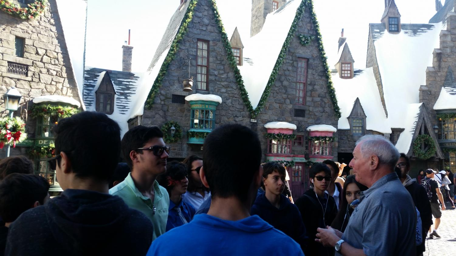 Tour guide tells the students about the new Harry Potter World.