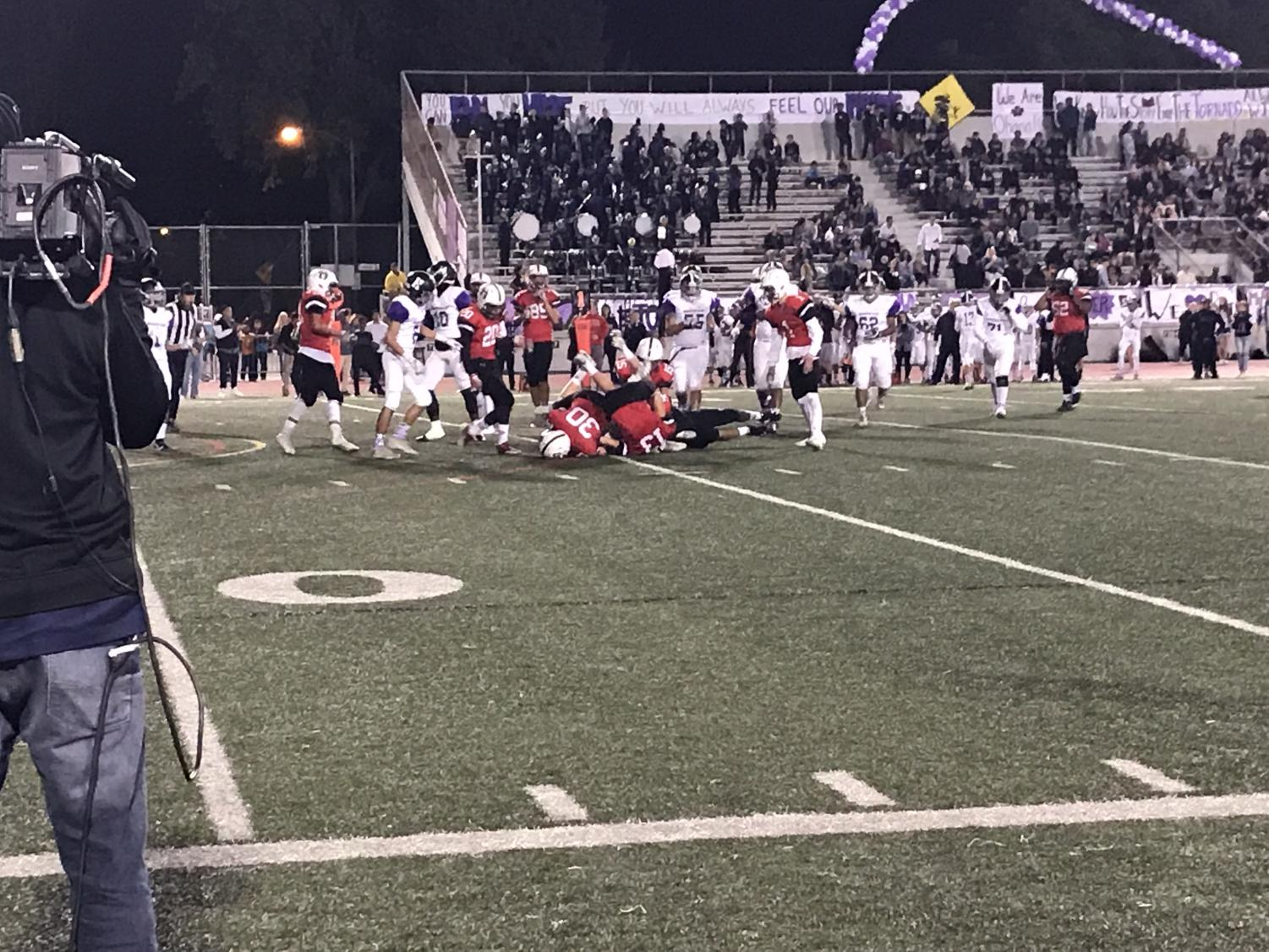 GHS tries to steal the ball by tackling Hoover's team.