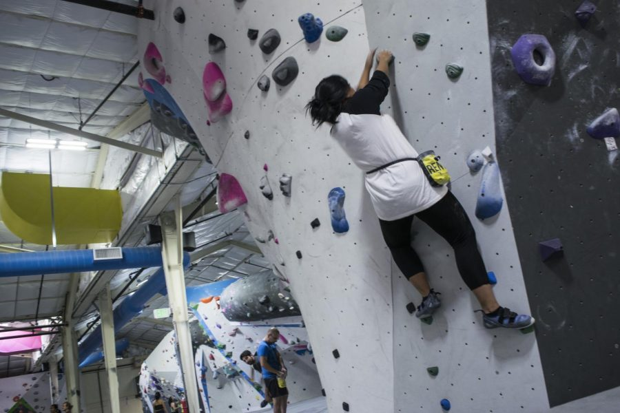 A climber climbs the V1