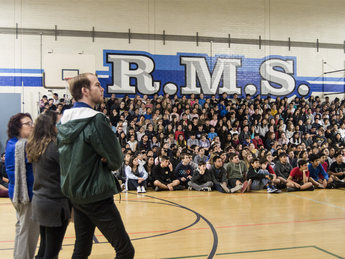 Teacher Eric Kursinski looks upon a group of Rosemont Middle school 8th graders during the presentation.