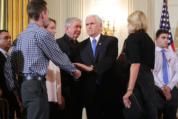 Vice President Mike Pence shakes the hand of a Parkland school shooting survivor.