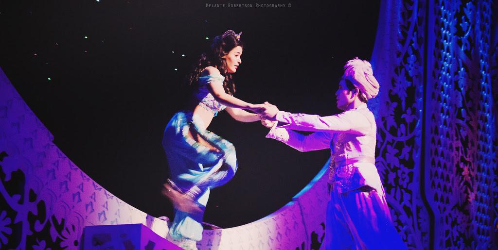 Aladdin helps Princess Jasmine step off the magic carpet.