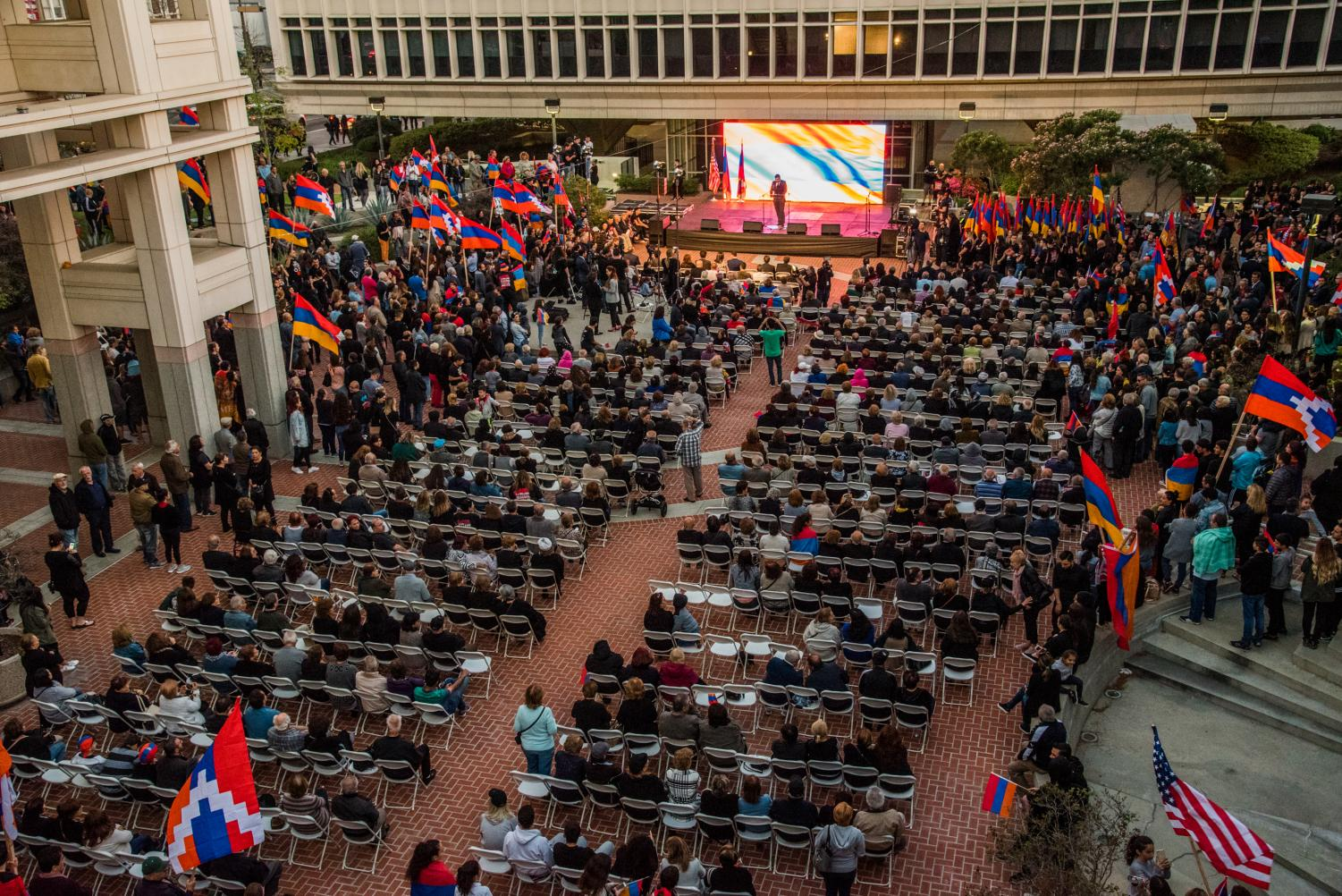 People gather at City Hall on April 23 to commemorate the Armenian Genocide.