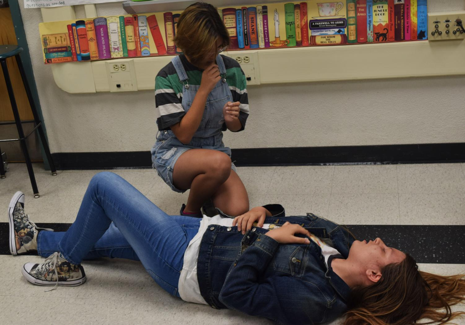 Freshmen Jannice Rigor and Katrina Saghi both reenact a scene from Romeo and Juliet