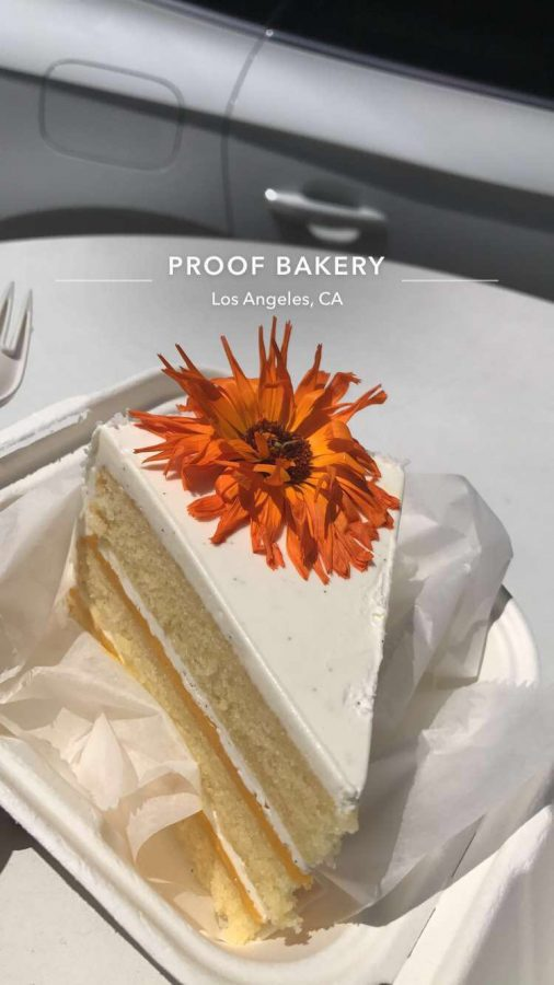 The vanilla passion fruit cake from Proof Bakery is rich in flavor and has a beautiful edible flower on top.