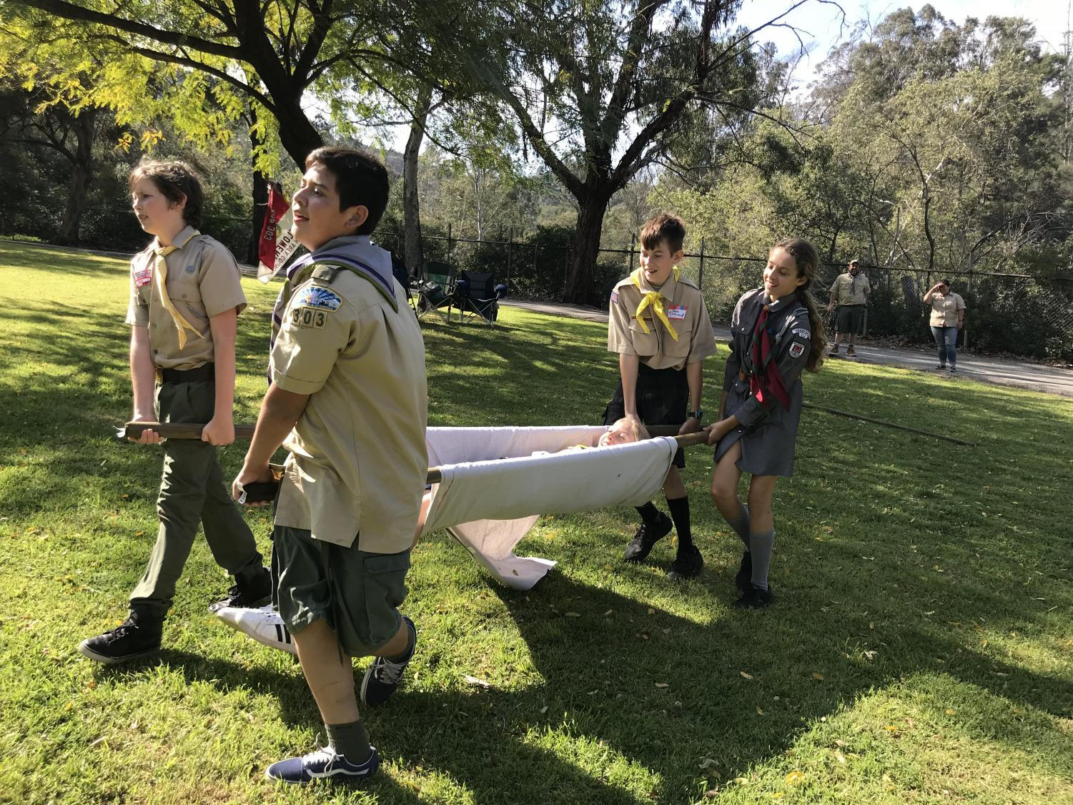A group of Boy and Girl Scouts practice their first-aid skills at International Scout Day meet-up at Griffith Park.