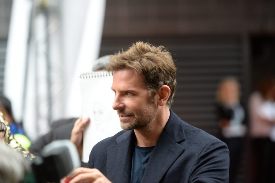 Bradley Cooper, the star of A Star is Born, walks the red carpet for the premiere.