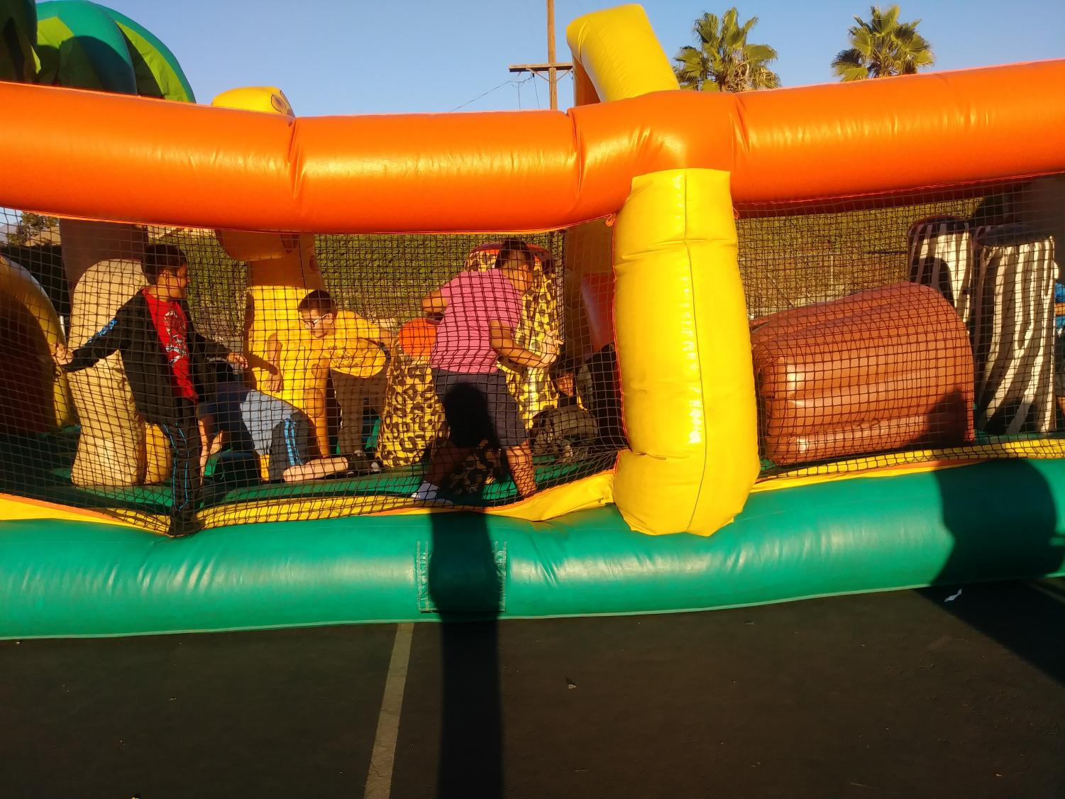 John+Muir+students+have+fun+in+the+bouncy+house+during+the+Monster+Mash.