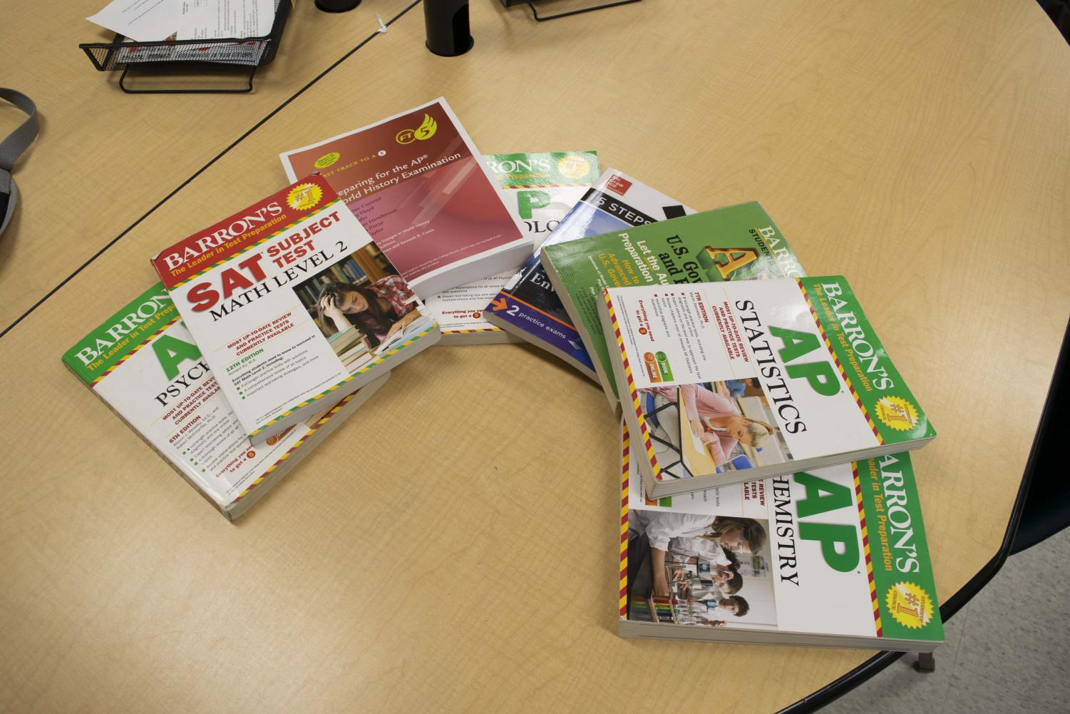 Several of the AP and SAT prep books that students use to study for nation-wide tests.