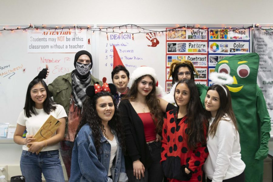 Mr. Kursinski and his students show off their Halloween costumes.