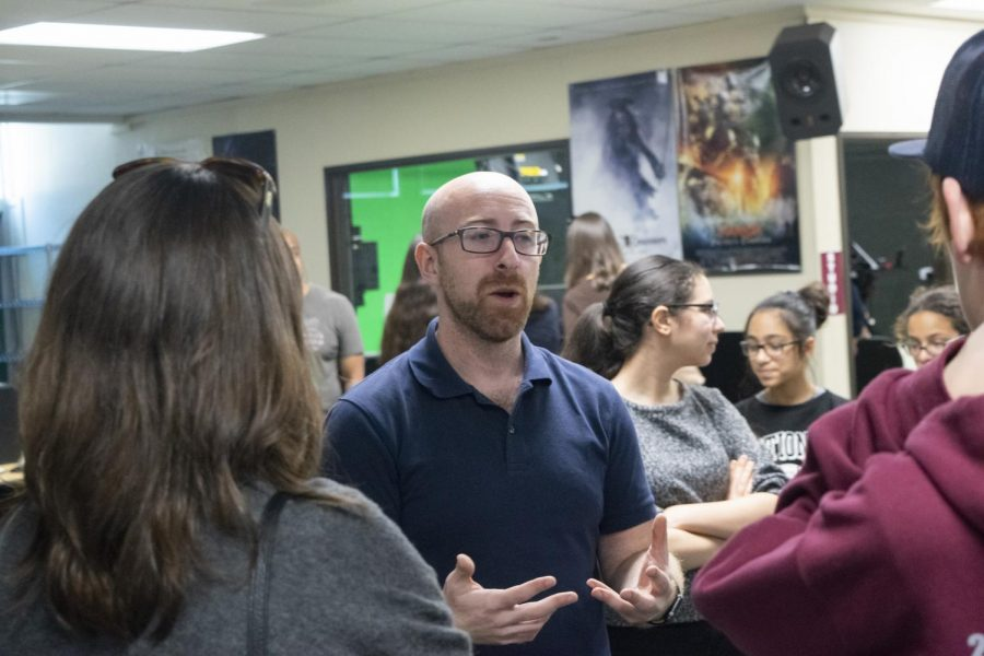 Cinema teacher Joshua Bishop talks with parents as they tour his classroom during the Clark EXPO.
