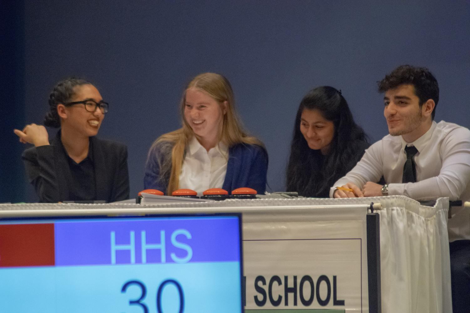 The Clark Magnet scholastic Bowl team takes a break during the Scholastic Bowl competition which was hosted at Glendale HS's auditorium.