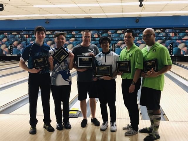Former junior bowlers, Anthony Schanen and Kevin Banaag (left), receive plaques for winning second place in a JAT doubles tournament.