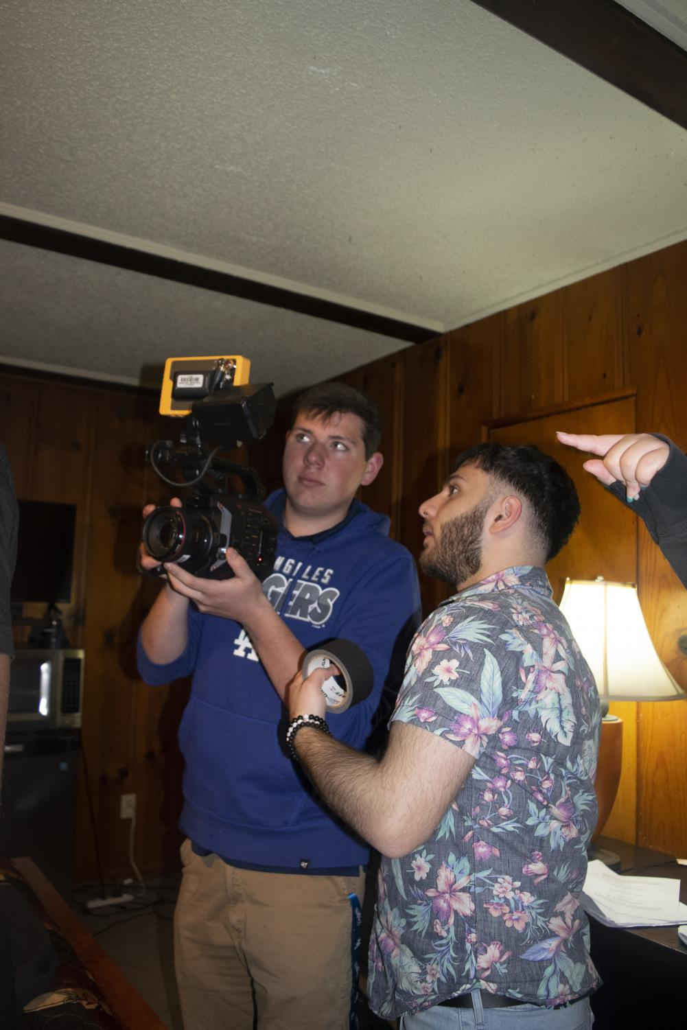 Senior Cameraman Wayne Baker and senior Director Harutyun Maranjyan look into the camera to make sure the lighting works with the scene.