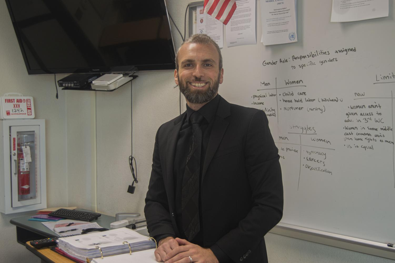 New history teacher Vardan Mikayelyan gets his classroom ready for the new school year.
