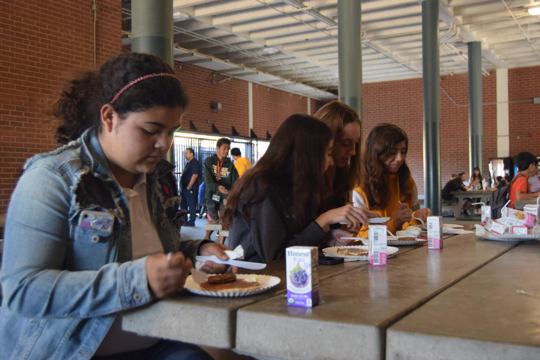 Freshman Sabrina Montoya (left) enjoys pancakes with her friends.