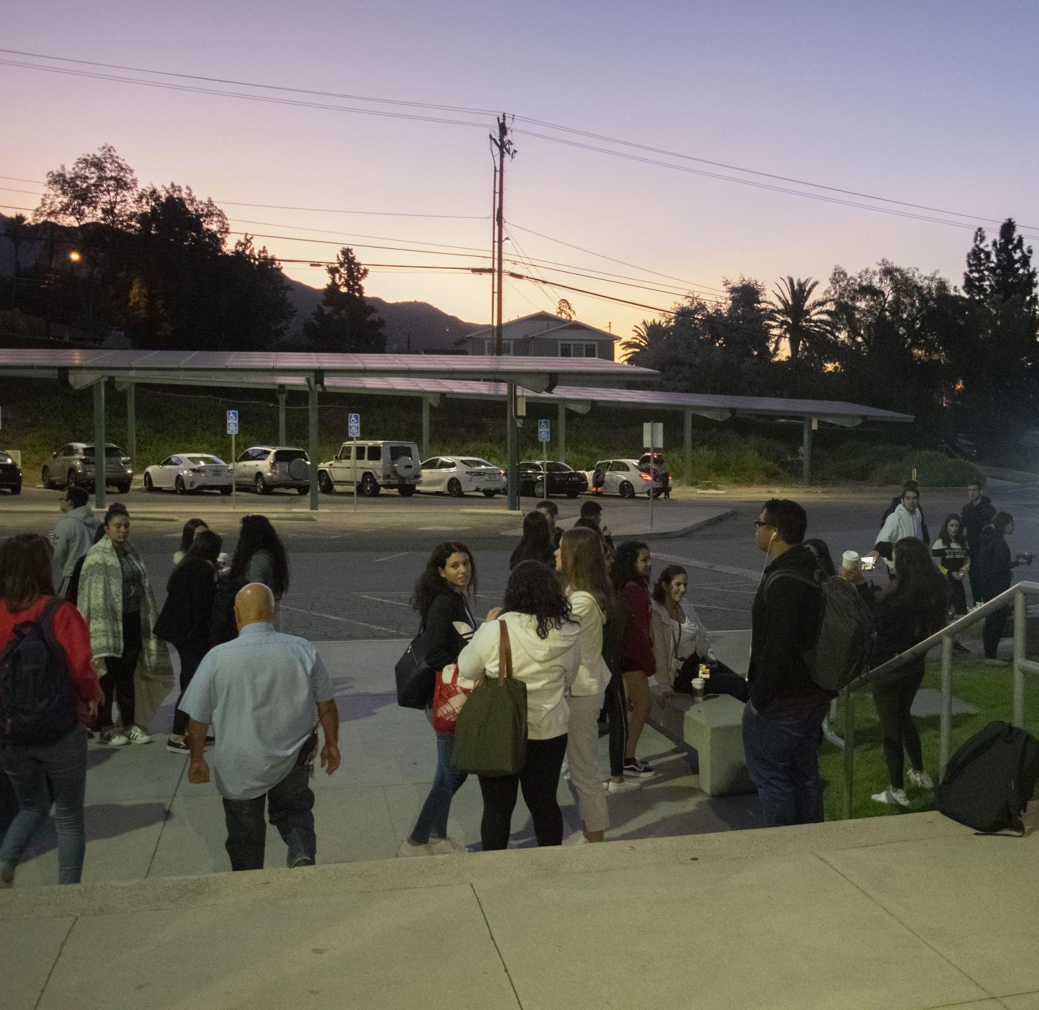 Seniors at Clark arrive at dawn to watch the sunrise while drinking hot chocolate.