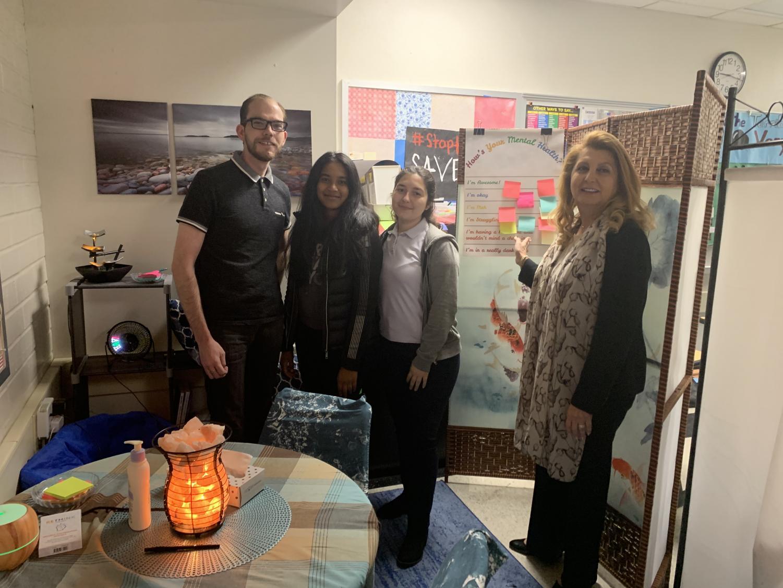 From left to right, Eric Kursinksi, Nagashreya Guntireddy, Ani Sahakian, and Superintendent Vivian Ekchian pose in Kursinki's relaxing area called the
