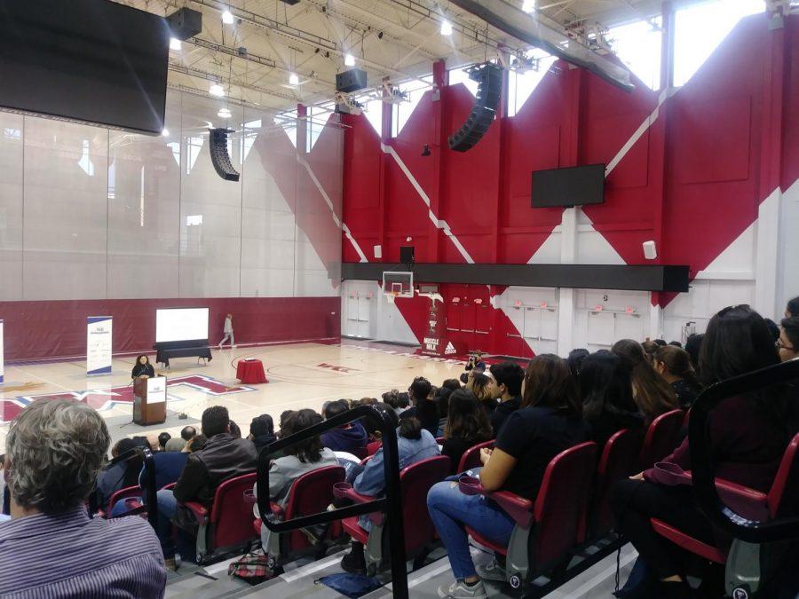 People listen to Anahi Godinez's introduction to College Prep Saturday.