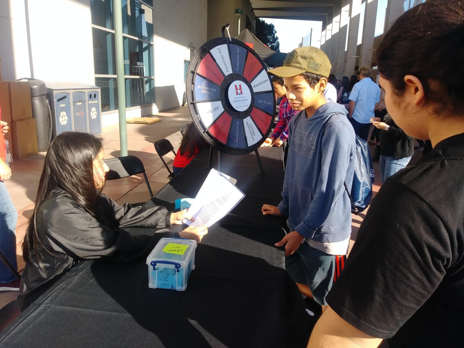 A College Prep Saturday participant plays an HSF trivia game, in which he had to spin the wheel and answer questions based on the categories.