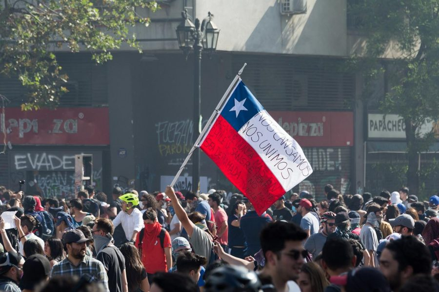 +Protesters+storm+the+streets+of+Santiago.+The+flag+has+written+on+it+%E2%80%9Cwe+got+tired.+We+united+so+that+never+again+in+Chile+will+sister+blood+be+spilled.+No+more+violence.%E2%80%9C
